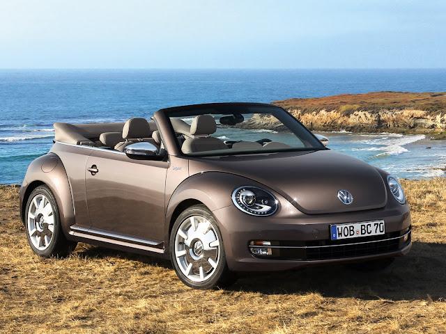 Brown 2013 Volkswagen Beetle Convertible 70s Edition front 3/4 view at ocean