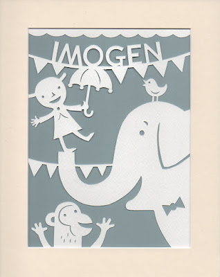 papercut picture of elephant and monkey and child