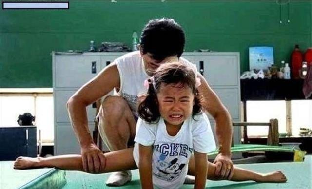 الصين وكيفية صناعة الأبطال الألومبيين China-gymnasium-Olympic-children-28