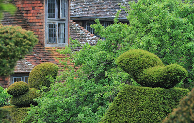 Great Dixter - Peacock Topiary and House
