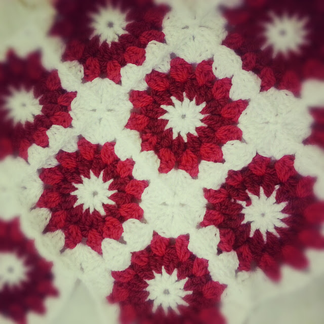 Crochet starburst cushion cover in red and white