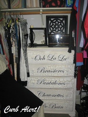 tall white dresser with crackle finish and cursive labels