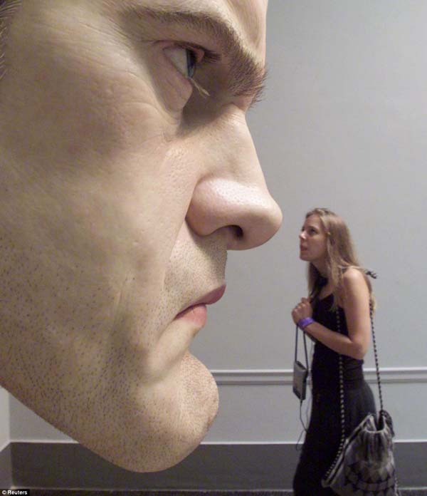Wonderful Pictures Of People That Seem To Be Real, But They Are Not - He even created a likeness of himself as an oversized mask.
