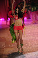 Adriana Lima wearing red lingerie at 2012 Victoria's Secret Fashion Show