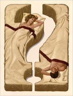 casal em dúvida na cama