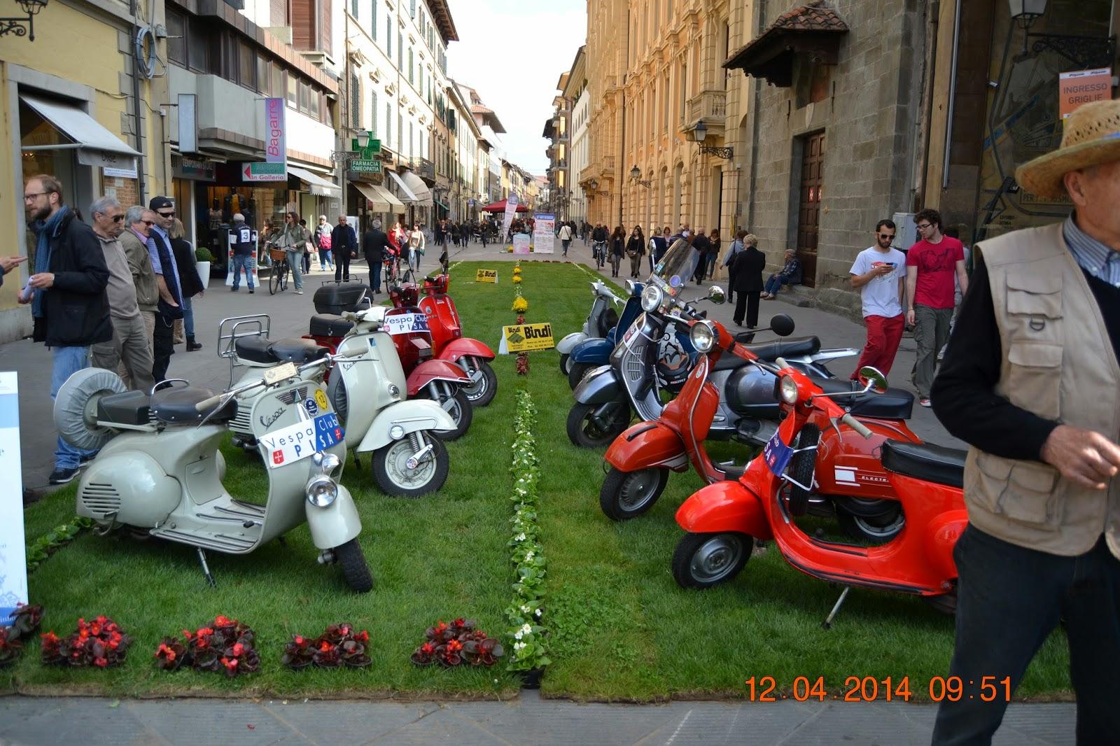 Colourful Vespa at a square in Pisa