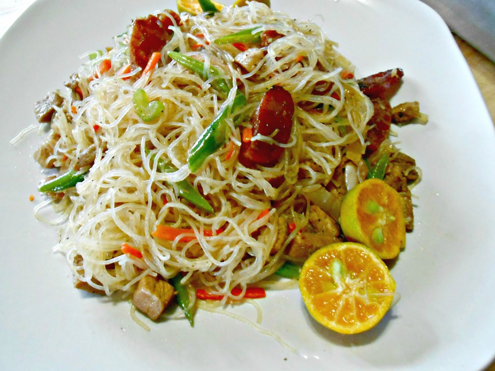 ... stir fried rice noodles with a mix of fresh vegetables like green