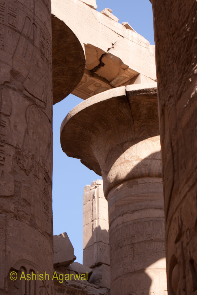 Pillars, close to each other, inside the Hypostyle Hall in the Karnak temple