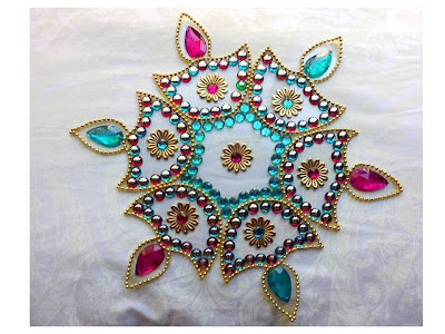 Diya Shaped Rangoli