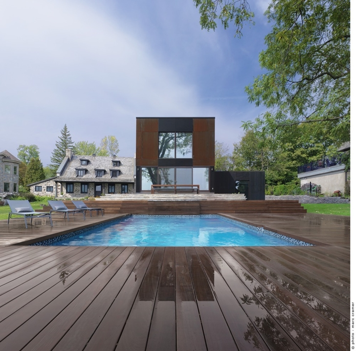 Swimming pool area in Renovated Bord-du-Lac House by Henri Cleinge