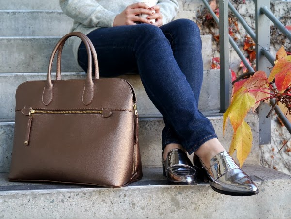 Gold saffiano leather bag from Roots and silver metallic 3.1 Phillip Lim loafers