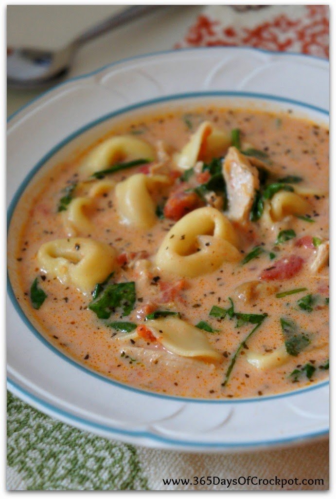 Tomato Parmesan soup with tortellini, spinach and chicken.  My new favorite soup!!