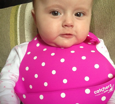 Baby E Wearing a Popping Pink Skibz Catcherz Bib
