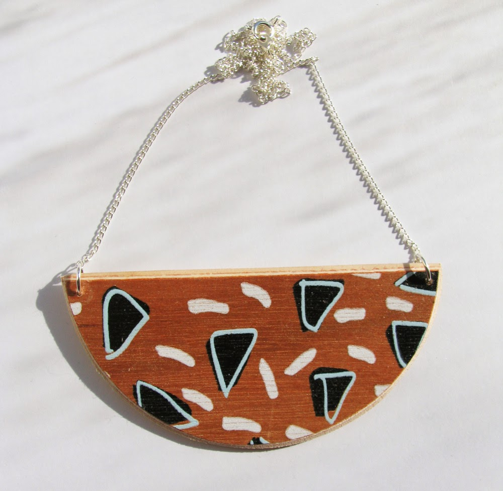 http://birdinborrowedfeathers.bigcartel.com/product/half-moon-necklace-by-ding-ding