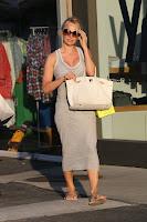 Pamela Anderson in a grey dress
