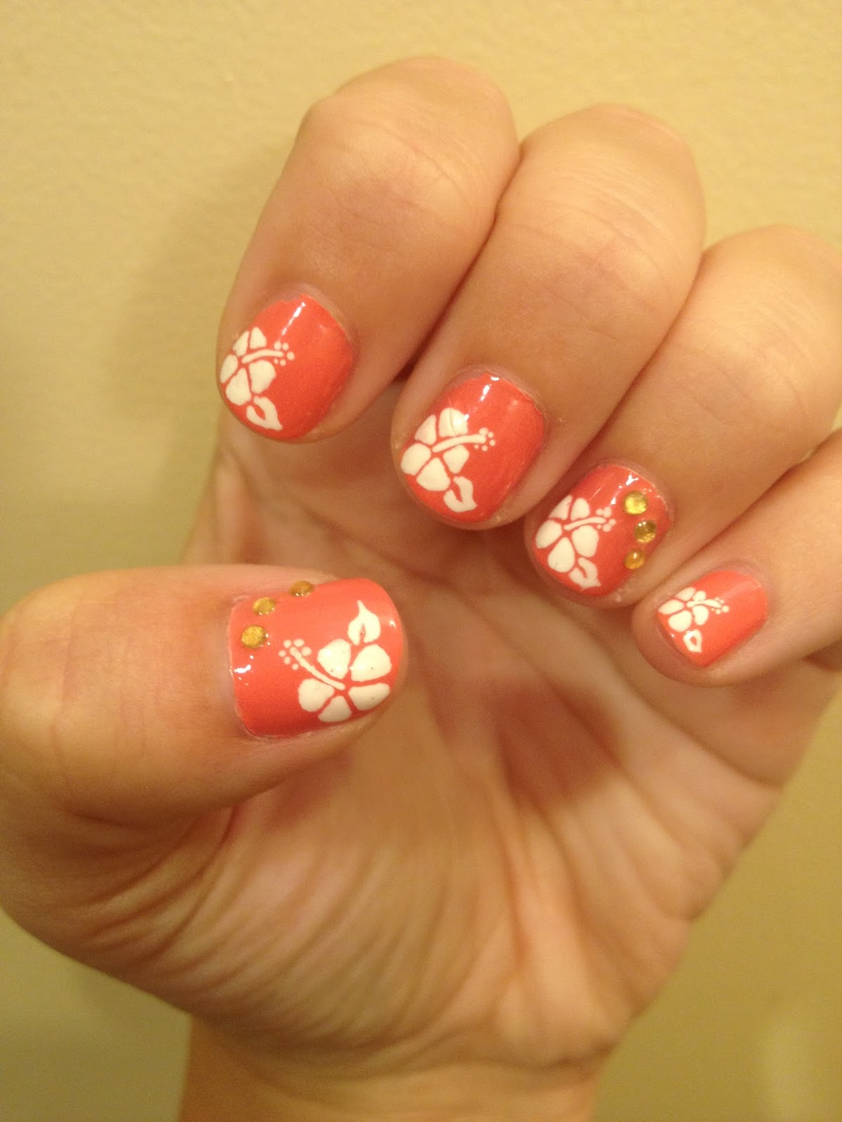 Nailed it hibiscus flower nails so i used a fun and bright peachy color as the base and white flowers using my migi nail pens with a little yellow gem accent nailed it 3 izmirmasajfo