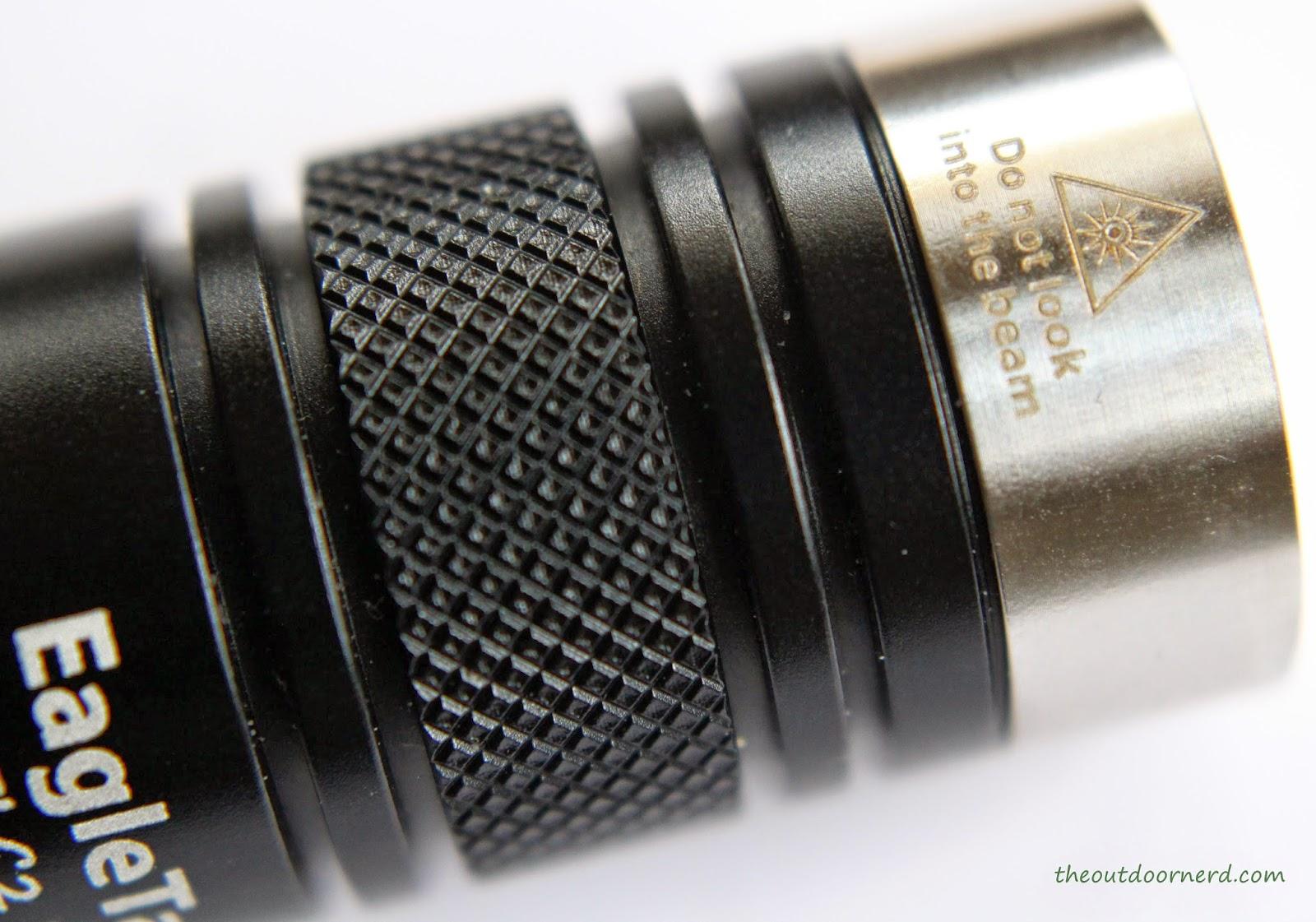 EagleTac D25LC2 Mini 18650 Flashlight: Closeup of Bezel