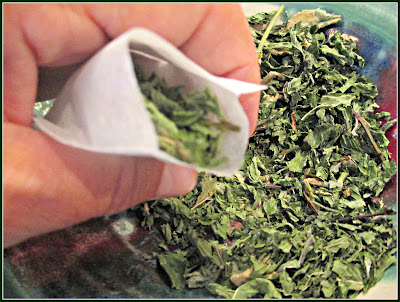 Tea Being Placed Into Small Tea Bags