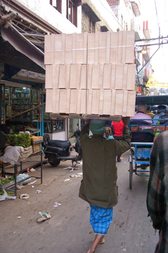 Carrying goods on head in India