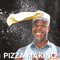 A man flipping a Pizza in the air