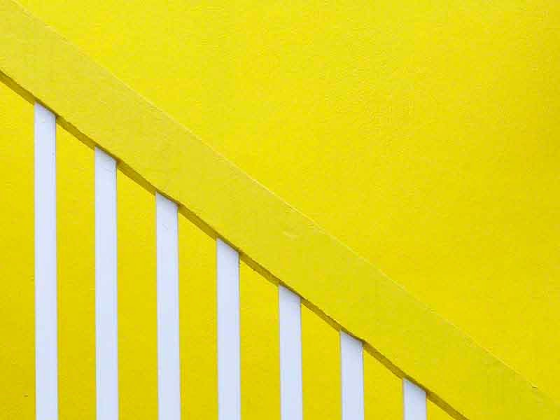 abstract, bright yellow building and staircase