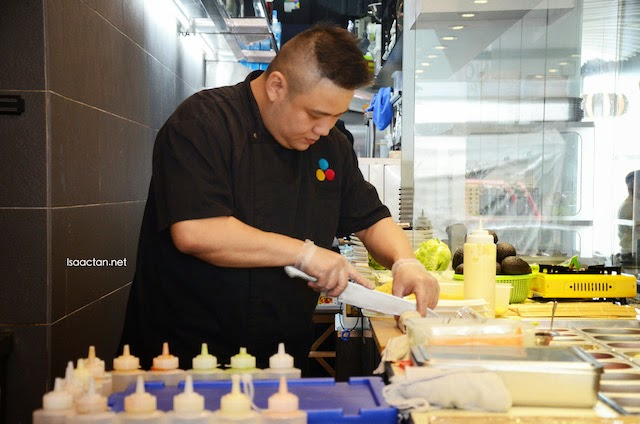 Okonomi chef preparing our customized sushi rolls