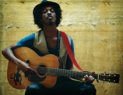 K'Naan Ft. Nelly Furtado - Is Anybody Out There Lyrics