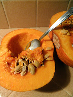 Spoon Scooping Seeds out of Pumpkin