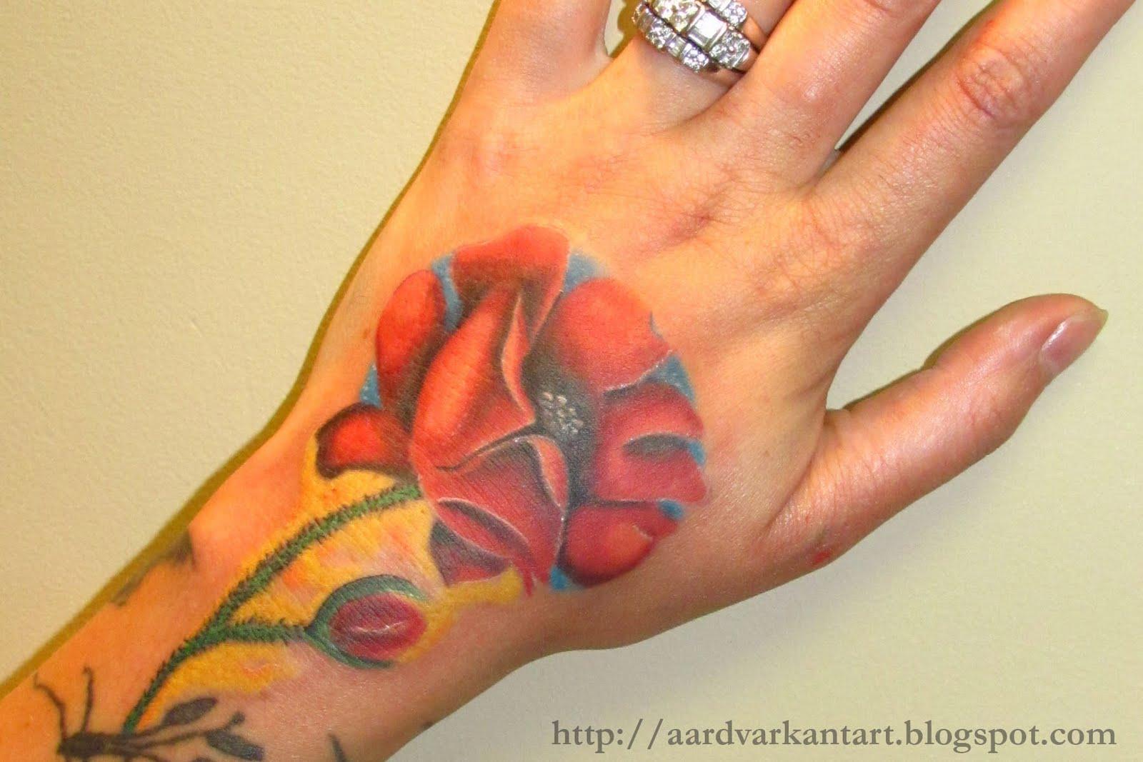 http://3.bp.blogspot.com/-NwmkagHapE0/TlpuTTxq70I/AAAAAAAAAfo/gdOW3SPcd5A/s1600/poppy+hand+tattoo.jpg