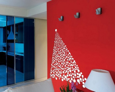 [A red wall with a Christmas tree sticker]