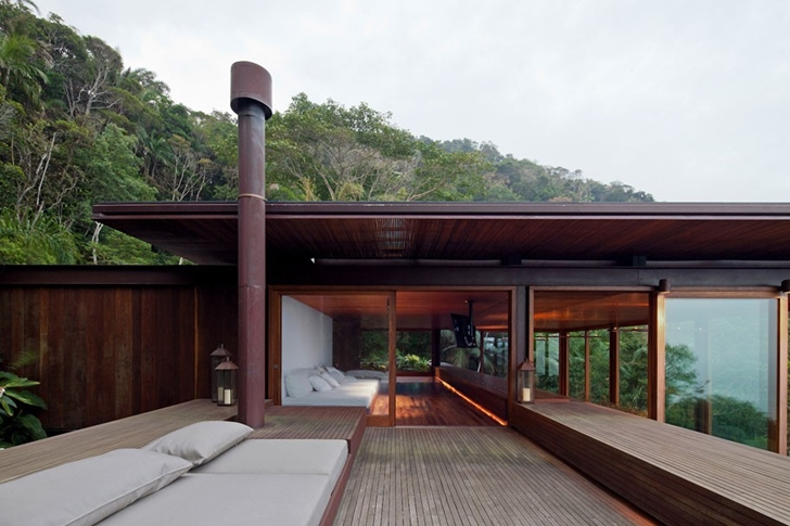 Terrace and bedroom of AMB House by Jacobsen Arquitetura
