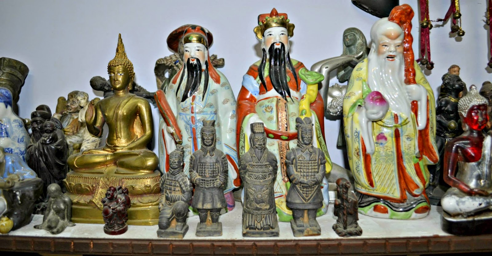 variety of antique figurines