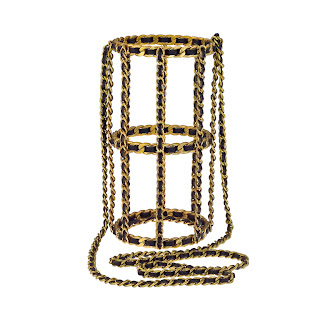 Vintage 1990's Chanel bottle holder constructed with their signature black leather and gold chain straps.