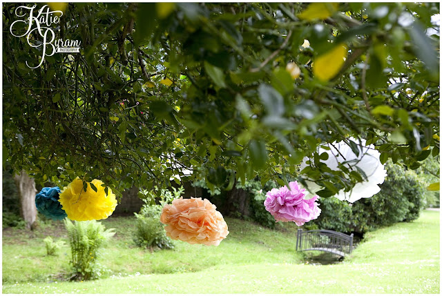 paper pom poms in tree, ellingham hall, ellingham hall wedding, northumberland wedding photographer, newcastle wedding photographer, ceremony signs, paper pom poms, quirky wedding photography, katie byram photography, diy wedding
