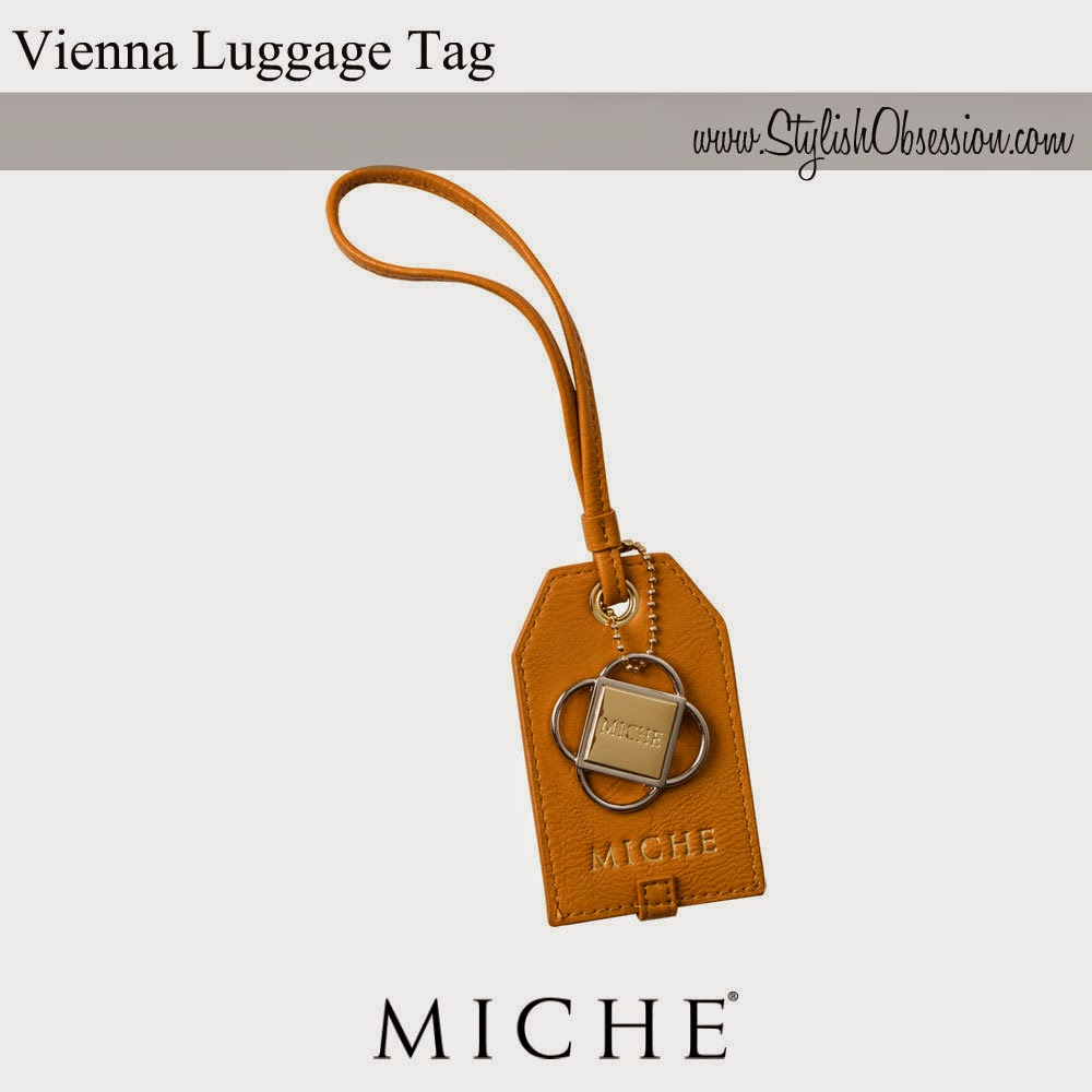 http://www.miche.com/party_share/dVJUbytIWDhyV2x3Vldsc1VGWXdvMVVOMWplOEN3ZVE%3D/shop/collections/vienna/vienna-luggage-tag.html