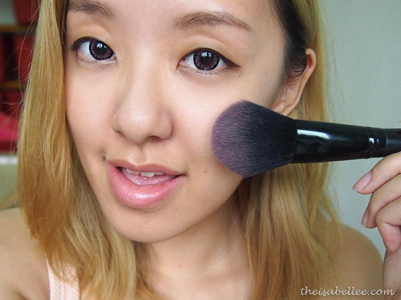 Applying Makeup Revolution Blushing Hearts blusher