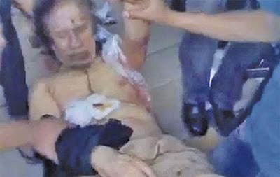 ANGGOTA pemberontak perkotak-katik mayat Gaddafi.