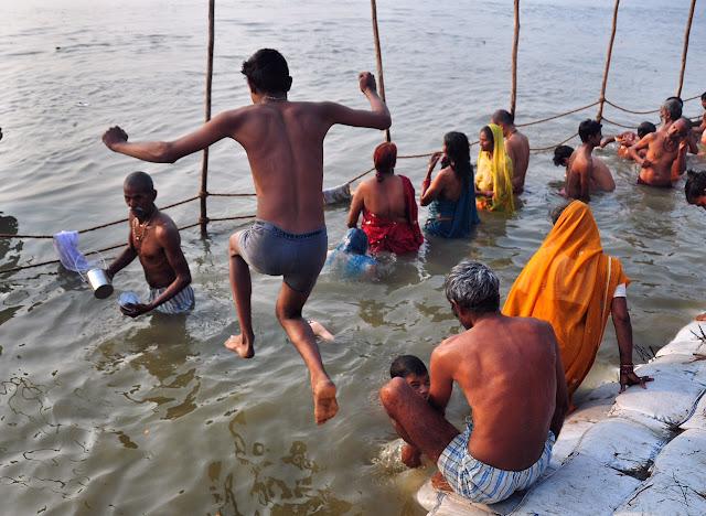 Indian man male boy underwear bathing at night Kumbh mela 2013 ganga allahabad