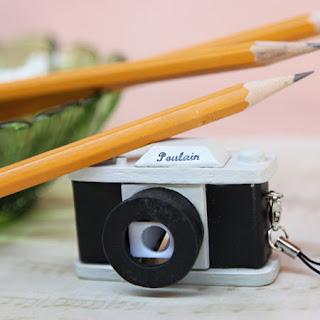 apontador escritorio maquina fotografica