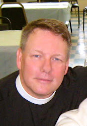 The Rev. Mark R. Collins