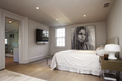 elegant and cool white master bedroom with beautiful focal point