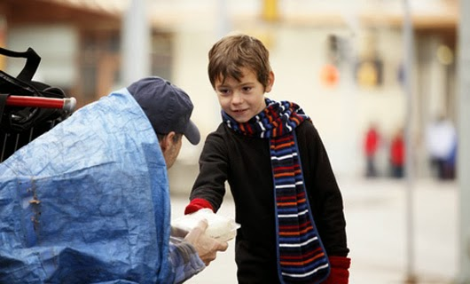 When this little boy brought a sandwich to a hungry homeless man on the street.