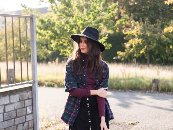 Outfit: wide brim hat, plaid shirt layering