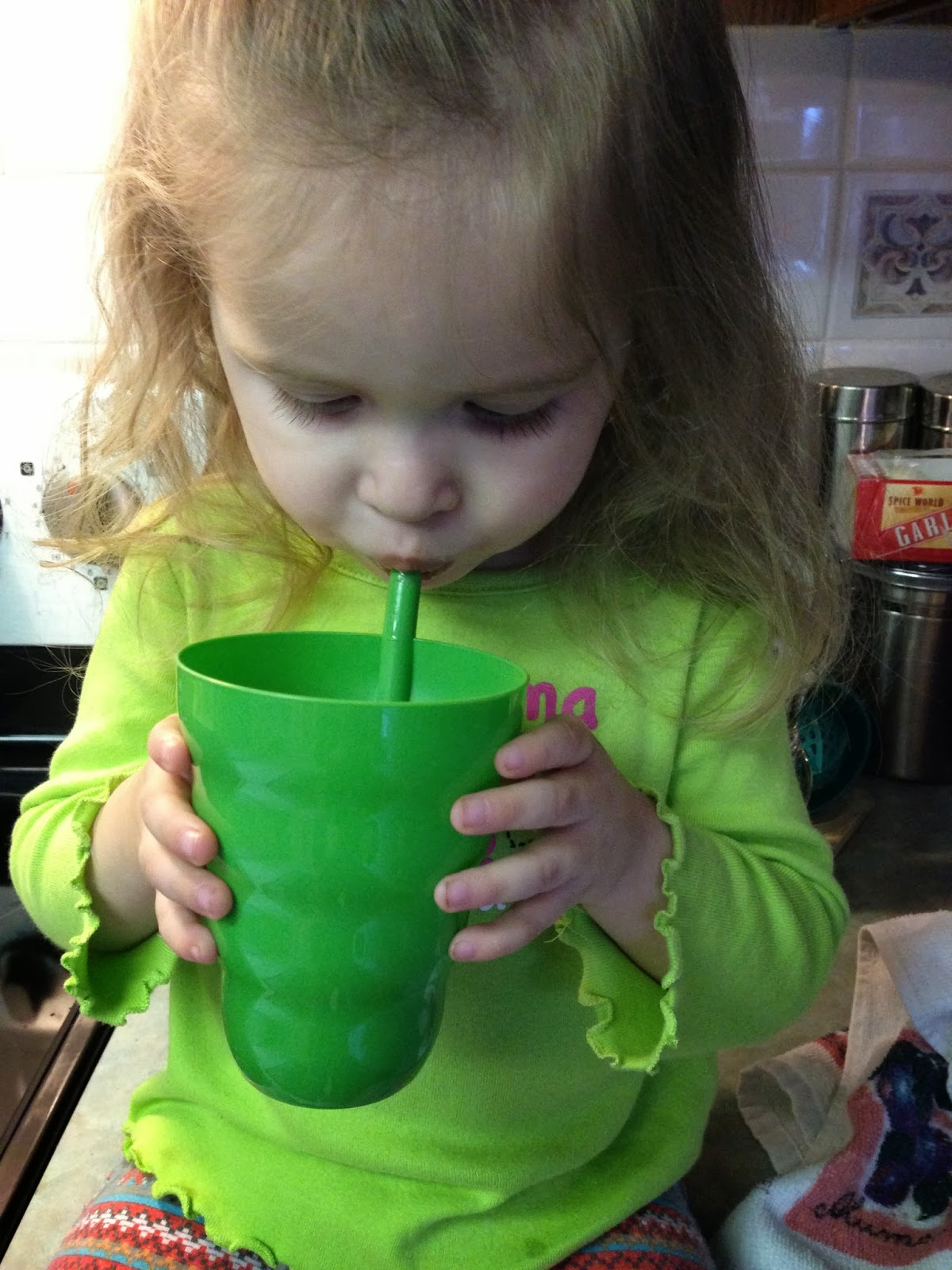Kid drinking chocolate peanut butter banana smoothie