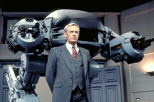 Ronny-Cox-with-ED-209-in-ROBOCOP_gallery_primary.jpg