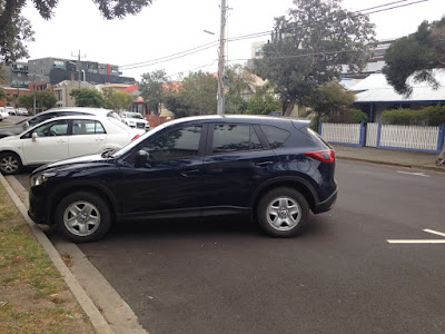 Rising waistline of the CX-5 disguises any slab sidedness
