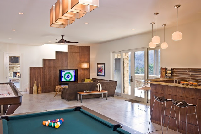 Photo of entertainment room with pool table and private bar