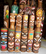Carved wood tiki masks and tiki wood statues from Bali