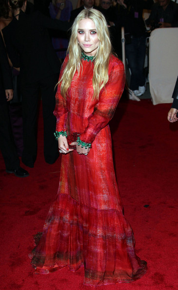 Mary-Kate Olsen in a long-sleeved red and green vintage Givenchy Haute Couture gown at the 2011 MET Gala.