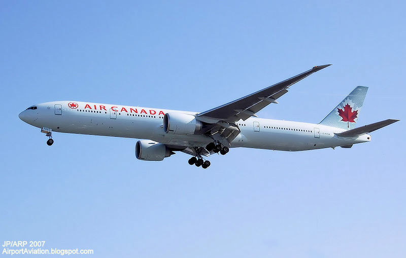 Air canada boeing 777-300er (c-fitw) lands at london heathrow airport